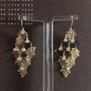 Diamond studded golden leaf earrings